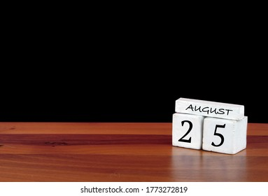 25 August calendar month. 25 days of the month. Reflected calendar on wooden floor with black background
