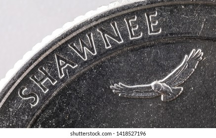 25 c cents, twenty five super macro 5x Close-up detail on a USA United States quarter dollar coin - SHAWNEE and Hawk