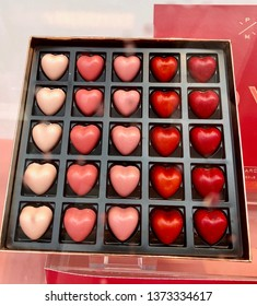 25 chocolate hearts in chocolate boxes