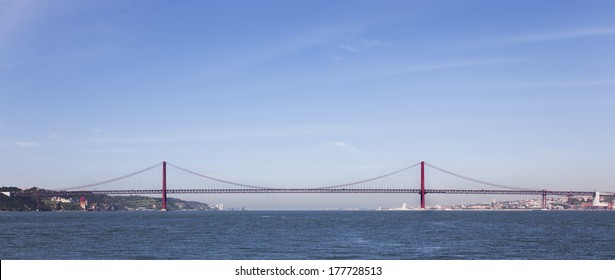 25 de Abril Bridge in Lisbon, Portugal. One of the largest suspension bridges in the world. Connects Lisbon and Almada cities crossing the Tagus River