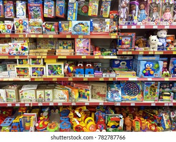25 Dec 2017, Russia, Rybinsk. Shelves with toys in the store. Range of children's products in the supermarket. Soft and plastic toys and educational games.