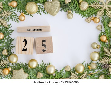 25 december perpetual calendar Christmas greeting card design Green frame made of Christmas trees and golden decorations,ball,snowflakes. Trendy greeting card design with copy space