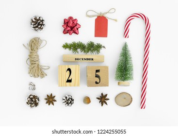 25 december perpetual calendar. Christmas flatlay compositiond. with christmas candy,tree rope, cones and anise star.