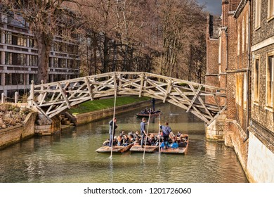 25 February 2015: Cambridge, UK - The Mathematical Bridge on a sunny day in winter,which joins two parts of Queens College, with a group of punts passing underneath.