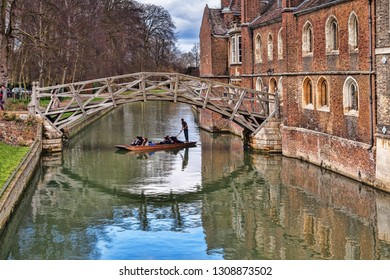 25 February 2015: Cambridge, UK - The Mathematical Bridge, which joins two parts of Queens College, with a punt passing underneath.