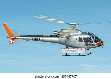 25 February 2017 F-HLLJ Airbus Helicopters H125 - Eurocopter AS350 B3e Ecureuil in flight over Courchevel Altiport, France. It is used to bring people over the Alps Mountains during winter holidays.
