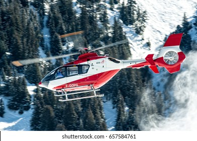 25 February 2017 Helicopter Eurocopter EC135 T1 Register F-GOPG used by SAF Helicopteres (Secours Aerien Francais). Take off from Courchevel Heliport, France, during winter holiday.