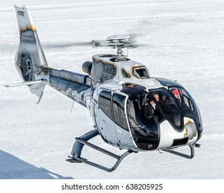 25 February 2017 Landing to Courchevel Heliport, France. White Eurocopter EC-130 Skycam Helicopter, it's landed here to bring skiers to the Alps during holidays. Courchevel 25/02/17 F-HIKE