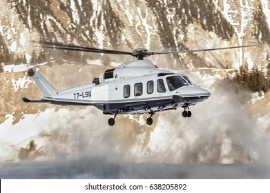 25 February 2017 Take off from Courchevel Heliport, France. White Agusta Westland AW-139 Private Helicopter, it's landed here to bring skiers to the Alps during holidays. Courchevel 25/02/17 T7-LSS