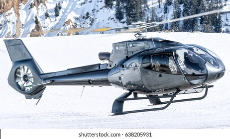 25 February 2017 Take off from Courchevel Heliport, France. Dark Eurocopter EC-130 Heli Securitè Helicopter, it's landed here to bring skiers to the Alps during holidays. Courchevel 25/02/17 F-HDRY