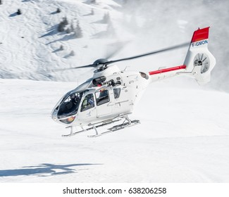 25 February 2017 Take off from Courchevel Heliport, France. White Eurocopter EC-135 SAF Helicopter, it's landed here to bring skiers to the Alps during holidays. Courchevel 25/02/17 F-GMON