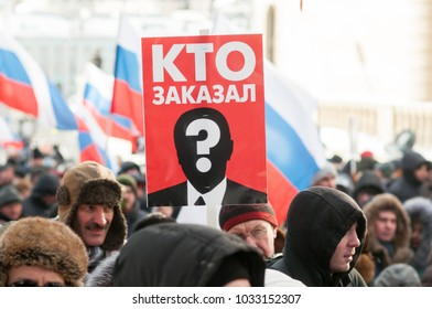 """25 FEBRUARY 2018, MOSCOW, RUSSIA. Poster in the crowd with words """"who is the customer"""" during the protest in memory of russian politician Boris Nemtsov"""