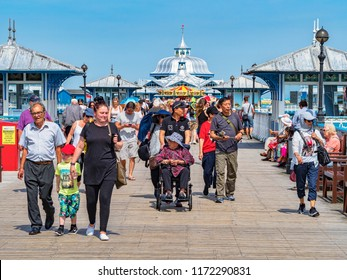 25 July 2018: Llandudno, Conwy, UK Busy Llandudno Pier, during a hot day at the height of the holiday season.