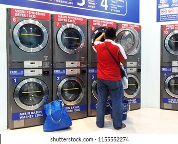 25 June 2018, Kuala Lumpur Malaysia; Laundry Self Service, 24 hour loundry that operate using coin or token has increase in demand. (Selective focus)