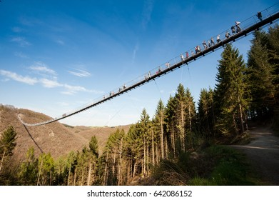 25 march 2017 Geierlay bridge Germany. Tourists crossing Geierlay bridge during planned trip