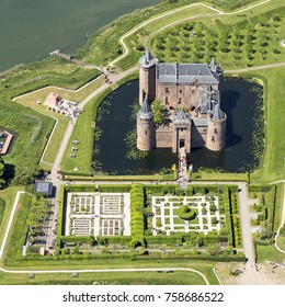 25 May 2017, Muiden, Holland. Aerial view of the medieval castle Muiderslot in Muiden, Netherlands. It lies on an island and has beautiful gardens.