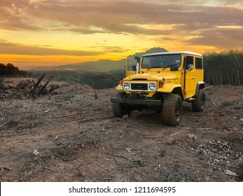 25 October 2018 , Sabah, Malaysia, Yellow Toyota Land Cruiser FJ40 with off road modification park in top hill in Kota Kinabalu , Sabah .Beautiful view of mount Kinabalu In background.
