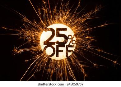 25% OFF sign in glowing sparkler on dark background.