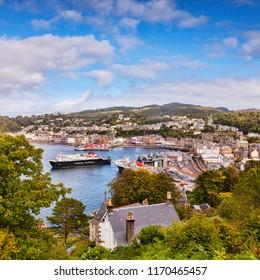 25 September 2015: Oban, Argyll and Bute, Scotland, UK -  CalMac ferry Clansman leaves Oban harbour.