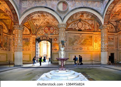 "25.04.2019. Florence, Italy. The Palazzo Vecchio (""Old Palace""). Interior of First courtyard with columns , tourists and water fountain."
