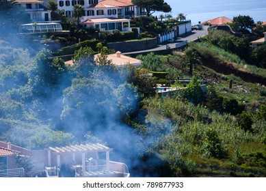 25.05.2017. MADEIRA, PORTUGAL. Smokes over village near Funchal city.