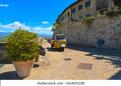 25.05.2019. Vintage Ape Piaggio car in old historic alley in the medieval village of Anghiari near city of Arezzo in Tuscany, Italy