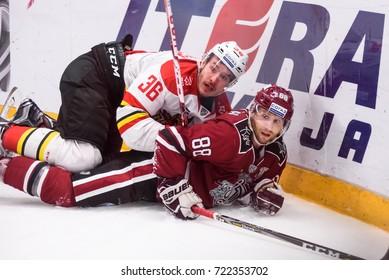 25.09.2017. RIGA,LATVIA. Joonas Jarvinen (L) and Brandon McMillan (R) Kontinental Hockey League (KHL) game  Dinamo Riga vs. HC Kunlun Red Star.