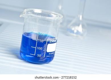 250ml measuring beaker with blue liquid