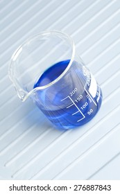 250ml measuring beaker filled with blue liquid