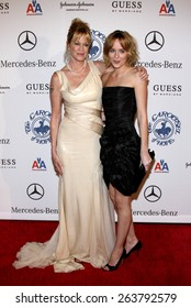 25/10/2008 - Beverly Hills - Melanie Griffith and Dakota Johnson at the 30th Anniversary Carousel Of Hope Ball held at the Beverly Hilton Hotel in Beverly Hills, California, United States.