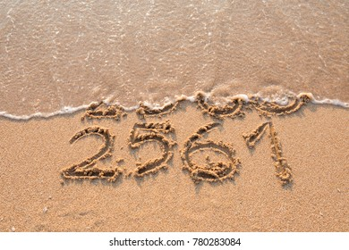 2561 Buddhist year coming beach concept.