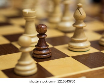 25.October 2018, Trnava, Slovakia The black chess pawn is surrounded by white figures on the chessboard.