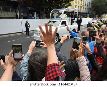 25th August 2018 Dublin. Papal visit to Ireland. People greet Pope Francis in his pope mobile on Westmoreland Street, Dublin City