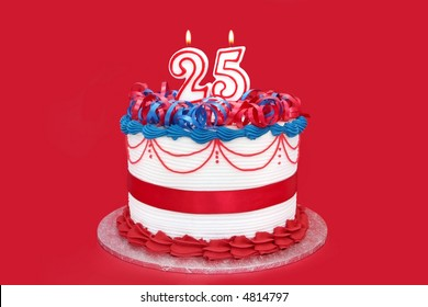 25th cake, with numeral candles, on vibrant red background.  Birthday, anniversary, etc.