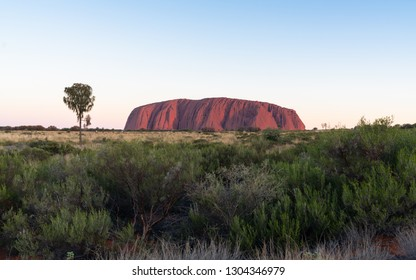 25th December 2018, Uluru NT Australia: Scenic sunset view on red Uluru in central outback Australia