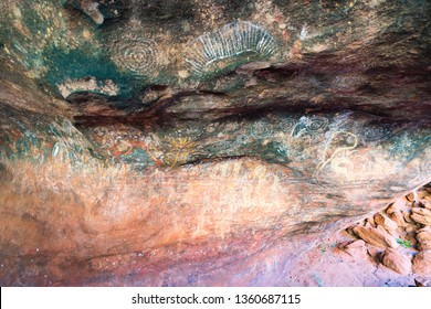 25th December 2018, Uluru NT Australia: Aboriginal cave painting inside the family cave or kulpi mutitjulu at Ayers rock in NT outback Australia