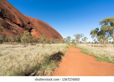 25th December 2018, Uluru NT Australia: View of red rocks and path of the base walk around Ayers rock in NT outback Australia