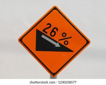 26% descending traffic sign
