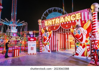 26 February 2021, UAE, Dubai: Entrance to the amusement park and child circus at funfair area of Global Village at night