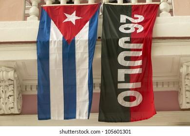26 July flag and Cuban flag, Havana, Cuba