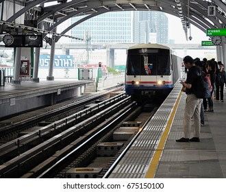 26 Jun 2017, Bangkok Thailand - Sky train or Metro is approaching or arriving the station while people are waiting on platform.