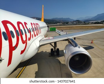 26 June 2019 / Gazipasha, Turkey: People boarding on an Airbus A320 plane of Pegasus Airlines on a transit trip to Istambul.