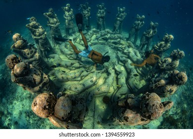 "26 March 2019 near island Gilli, Indonesia. An underwater sculpture in Indonesia ""Nest"" take divers to a hauntingly beautiful place below the surface, where human figures will slowly become a coral"