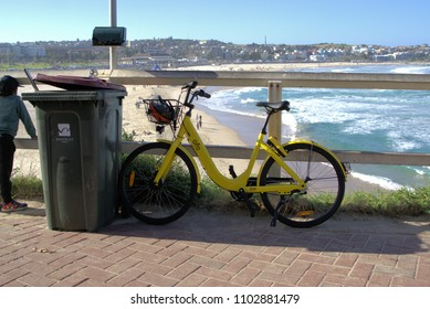 26 May 2018. Ofo bike parked at Bondi beach in Sydney Australia. Ride sharing rental bicycle parked against garbage bin in Sydney. Illustrative editorial only