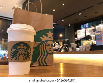 26 May 2019; Bangkok Thailand: Starbucks signature hot coffee cup with Starbucks paper bag at Starbucks Coffee Shop