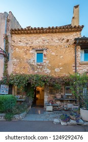 26 September, 2018 - Old Town of Roussillon, Provence, France: One of the most beautiful villages of France (Les Plus Beaux Villages de France), is situated by the ochre Red Cliffs (Les Ocres)