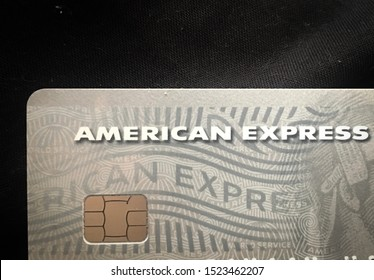 26 September 2019, Brighton, United Kingdom. Pile of American Express card, business concept, credit card on the table, amex logo