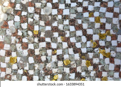 A 2,600 year old section of Ancient Greek Opus Regulatum floor mosaic exposed to the elements at the ruins of Megara