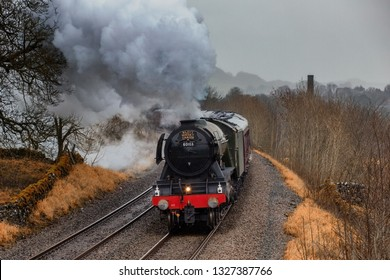 26.01.2019, Langcliffe, North yorkshire, UK, The Flying Scotsman at full speed with steam bellowong out of its pot thunders through Langcliffe in the Yorkshire Dales on its way to Carlisle.