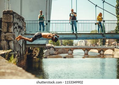 26.04.2018 Sarajevo Bosnia and Herzegovina, Pakistani Immigrant jumping in river Miljacka searching for refreshment while taking a break on their Balkan Bosnian rout to EU in search for asylum